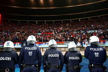Soccer Football - 2018 World Cup Qualifications - Europe - Austria vs Serbia - Ernst Happel Stadion, Vienna, Austria - October 6, 2017 Fans are watched by police during the game REUTERS/Leonhard Foeger
