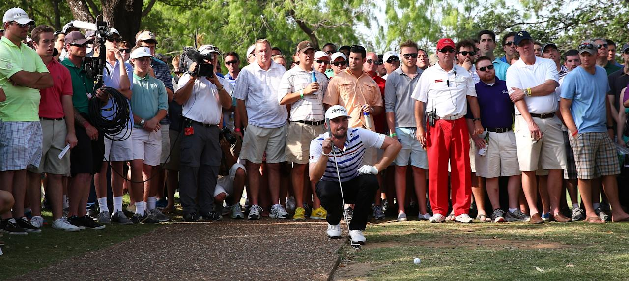 IRVING, TX - MAY 17:  Keegan Bradley lines up his shot on the 18th hole after his ball landed next to the cart path during the second round of the 2013 HP Byron Nelson Championship at the TPC Four Seasons Resort on May 17, 2013 in Irving, Texas.  (Photo by Tom Pennington/Getty Images)