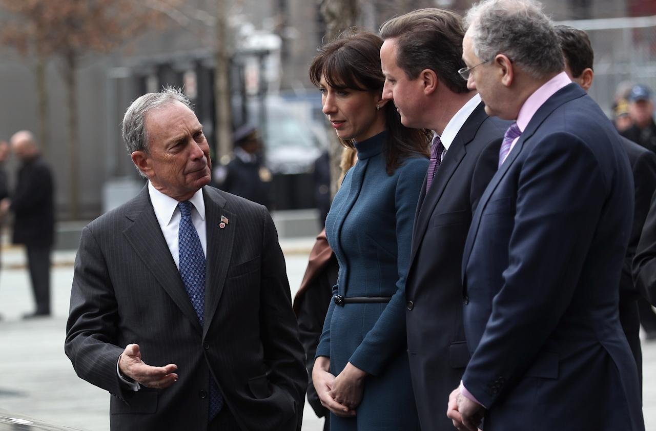 New York City Mayor Michael Bloomberg (L) speaks with British Prime Minister David Cameron (2R) and his wife Samantha at the World Trade Center Memorial on March 15, 2012 in New York, New York. The Camerons paid homage to victims of the terrorist attacks of September 11, 2001 whilst on the third and final day of their official visit to the United States. At right is Charles Wolf, the husband of Katherine Wolf, a British citizen who died at Ground Zero during the attacks.  (Photo by John Moore/Getty Images)