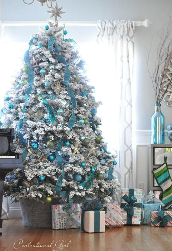 """<p>The soft colors— blue, silver, and white — make for an easy-on-the-eyes Christmas tree display. </p><p><em><a href=""""http://www.centsationalgirl.com/2012/12/white-blue-christmas-tree/"""" rel=""""nofollow noopener"""" target=""""_blank"""" data-ylk=""""slk:Get the tutorial at Censational Girl »"""" class=""""link rapid-noclick-resp"""">Get the tutorial at Censational Girl »</a></em></p>"""