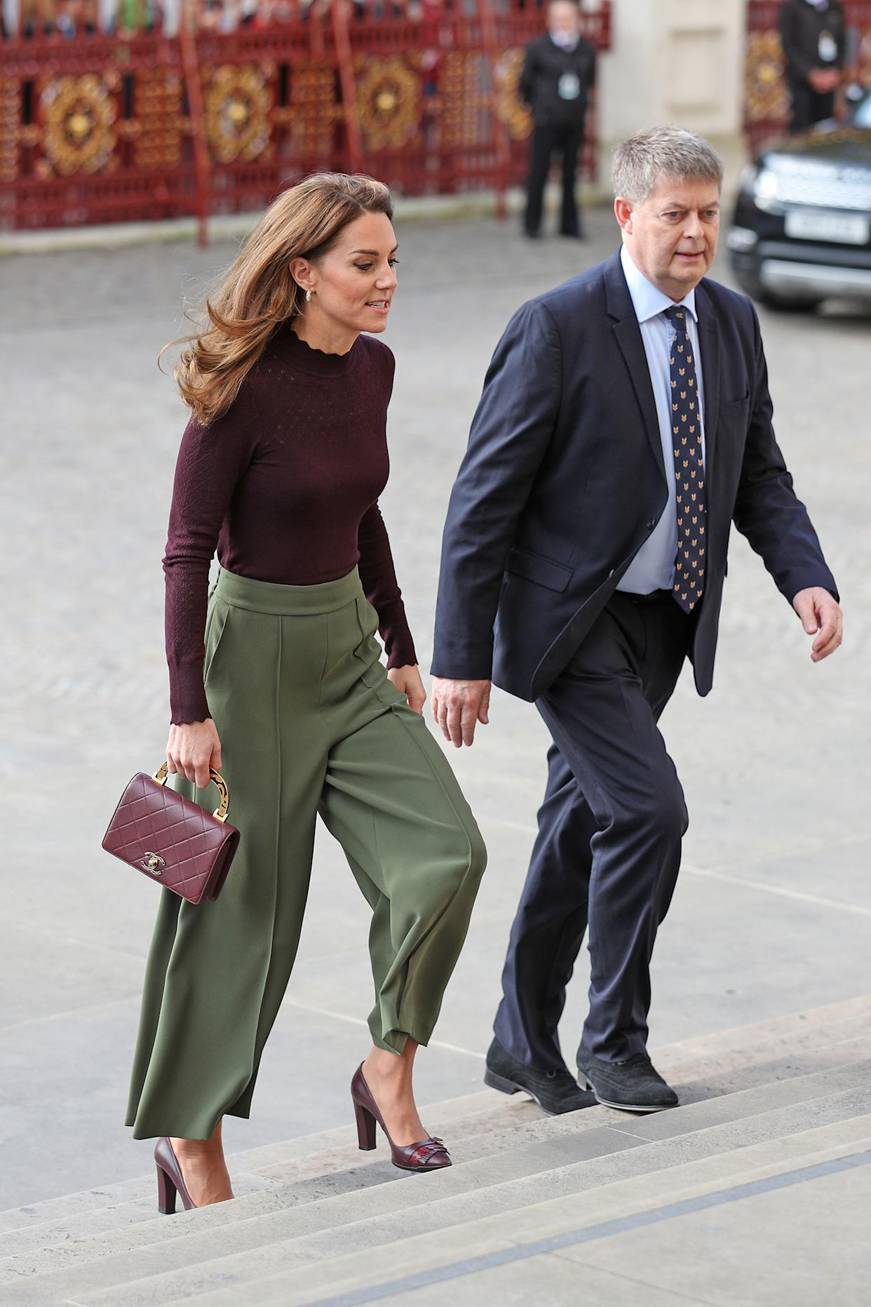 The Duchess of Cambridge teamed a pair of Warehouse culottes with a berry, lightweight knit from Warehouse [Photo: Getty]