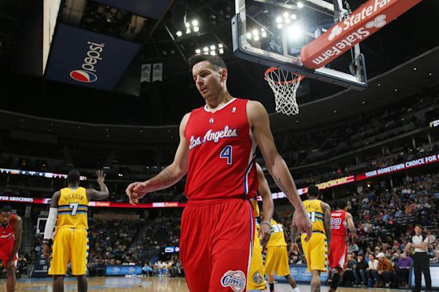 Los Angeles Clippers guard J.J. Redick waits to put the bal into play against the Denver Nuggets in the first quarter of an NBA basketball game in Denver on Monday, Feb. 3, 2014. (AP Photo/David Zalubowski)