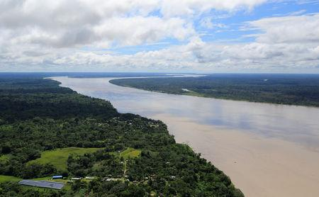 FILE PHOTO: An aerial view of the Amazon river, before the signing of a document by Colombia's President Juan Manuel Santos that will allow for the conservation of the Tarapoto wetland complex in Amazonas, Colombia January 18, 2018. REUTERS/Jaime Saldarriaga/File Photo