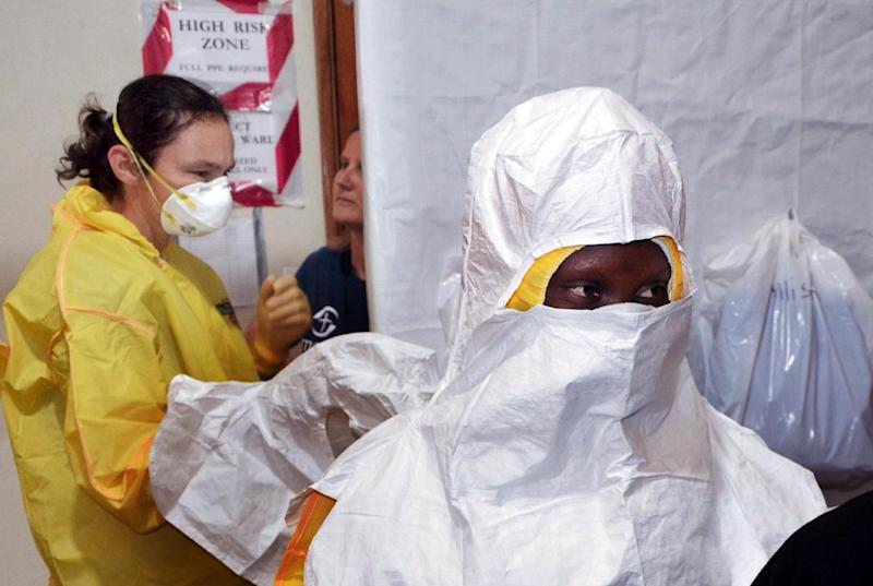Staff of the Christian charity Samaritan's Purse put on protective gear in the ELWA hospital in the Liberian capital Monrovia on July 24, 2014