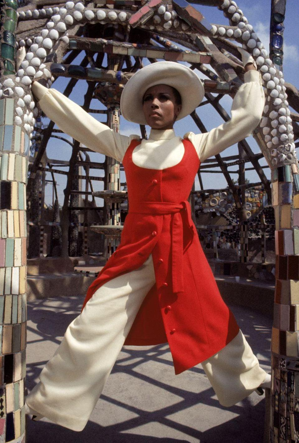 <p>Diahann Carroll struts a pose in a dress worn over pants. <br></p>
