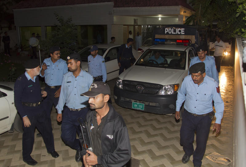 Police officers escort a vehicle carrying the family of Osama bin Laden, in Islamabad, Pakistan on Thursday, April 26, 2012. A van carrying the three widows and children of Bin Laden has left the house where they have been staying in Islamabad and is en route to the airport, from where they will be deported to Saudi Arabia, officials and witness said. (AP Photo/B.K. Bangash)