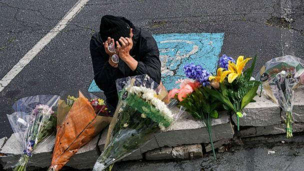 PHOTO: Woojin Kang, 27, cries at the makeshift memorial outside Gold Spa near Acworth, Ga., on March 18, 2021. (Chang W. Lee/The New York Times via Redux, FILE)