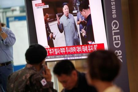 A South Korean soldier watches a TV showing a file footage for a news report on North Korea firing a missile that is believed to be launched from a submarine, in Seoul