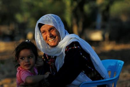 Muftia, the grandmother of U.S. congresswoman Rashida Tlaib, is seen with her granddaughter outside her house in the village of Beit Ur Al-Fauqa in the Israeli-occupied West Bank