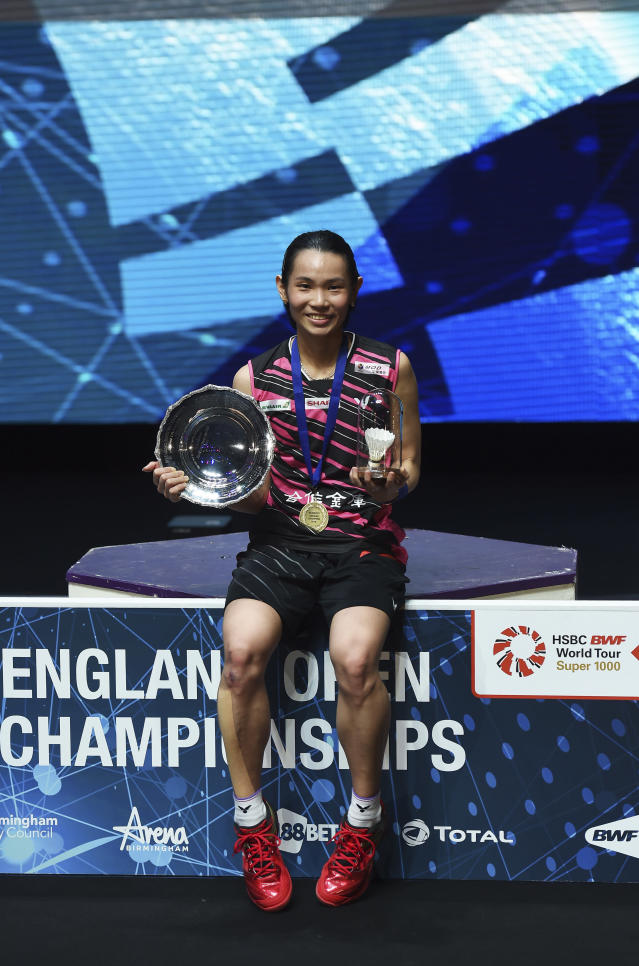 Taiwan's Tai Tzu Ying poses with her trophy after defeating Japan's Akane Yamaguchi in the women's singles final match at the All England Open Badminton tournament in Birmingham, England, Sunday March 18, 2018. (AP Photo)