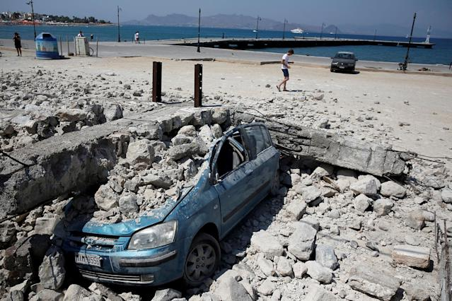 <p>A car is seen under the debris of a collapsed building, after an earthquake off the island of Kos, Greece July 21, 2017. (Photo: Costas Baltas/Reuters) </p>