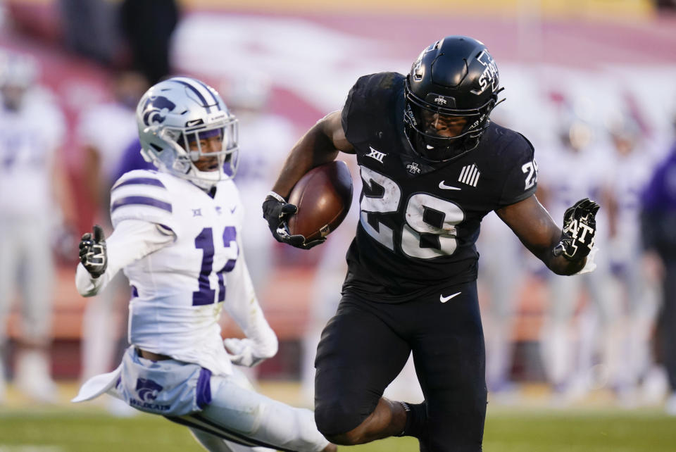 Iowa State running back Breece Hall (28) scores on a 21-yard touchdown run ahead of Kansas State defensive back AJ Parker (12) during the first half of an NCAA college football game, Saturday, Nov. 21, 2020, in Ames, Iowa. (AP Photo/Charlie Neibergall)