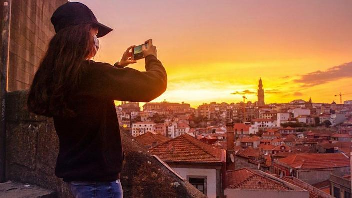A girl takes pictures of Porto