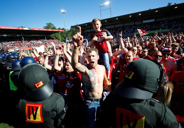 Soccer Football - 2. Bundesliga - SV Sandhausen v Nuremberg - BWT-Stadion am Hardtwald, Sandhausen, Germany - May 6, 2018 Nuremberg celebrate promotion after the match REUTERS/Kai Pfaffenbach DFL RULES TO LIMIT THE ONLINE USAGE DURING MATCH TIME TO 15 PICTURES PER GAME. IMAGE SEQUENCES TO SIMULATE VIDEO IS NOT ALLOWED AT ANY TIME. FOR FURTHER QUERIES PLEASE CONTACT DFL DIRECTLY AT + 49 69 650050