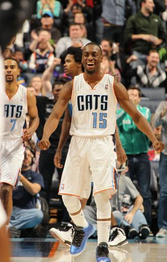 CHARLOTTE, NC - JANUARY 26: Kemba Walker #15 of the Charlotte Bobcats celeberates during the game against the Minnesota Timberwolves at the Time Warner Cable Arena on January 26, 2013 in Charlotte, North Carolina. (Photo by Kent Smith/NBAE via Getty Images)