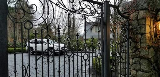 Harry and Meghan are living in a private waterfront mansion on vancouver Island, seen here beyond the gate