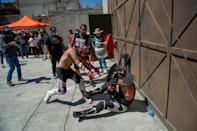 Wrestlers hit each other with chairs and even tube lights in the extreme version of 'lucha libre' -- Mexico's wildly popular mix of sport and entertainment