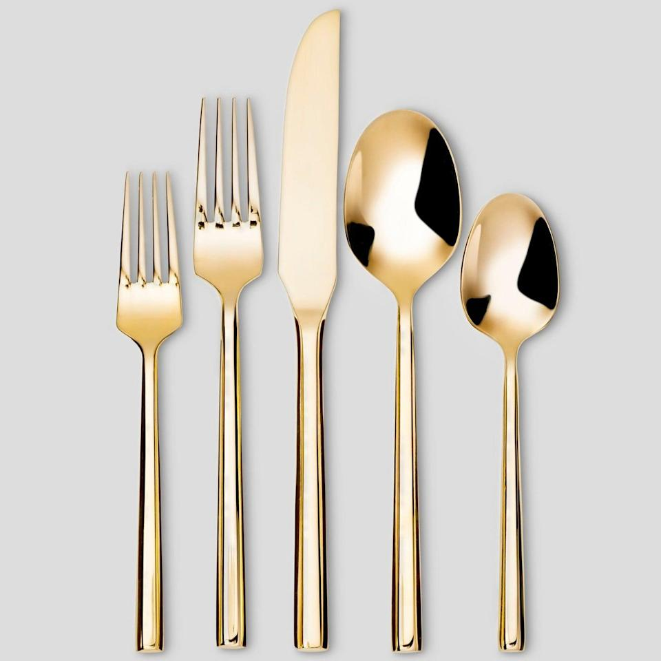 <p>Do they like throwing dinner parties? This <span>Gold Silverware Set</span> ($20) will kick their table setting up a notch.</p>