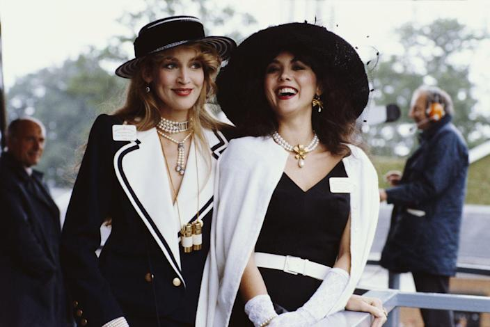 <p>Jerry Hall and Marie Helvin in black-and-white ensembles at the Royal Ascot. </p>