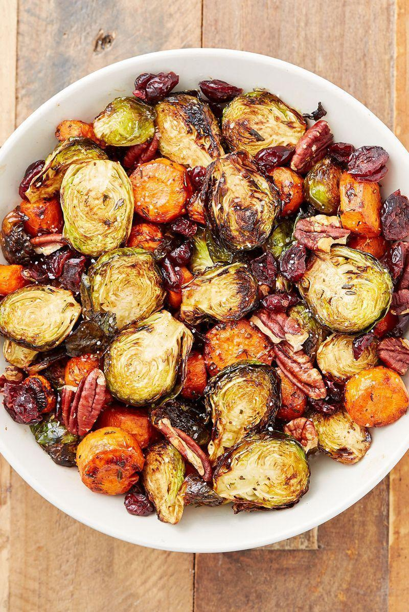 """<p>The dried cranberries add a tartness while the pecans add an extra crunch for a perfect side dish. We use Brussels sprouts and carrots in our medley, but feel free to add extra vegetables or swap in some of your favourites.</p><p>Get the <a href=""""https://www.delish.com/uk/cooking/recipes/a28934240/holiday-roasted-vegetables-recipe/"""" rel=""""nofollow noopener"""" target=""""_blank"""" data-ylk=""""slk:Classic Roasted Vegetables"""" class=""""link rapid-noclick-resp"""">Classic Roasted Vegetables</a> recipe.</p>"""