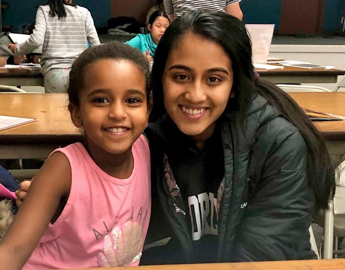 """<p>When the pandemic hit, Ankitha Kumar began receiving frantic texts from students she helped at the local tutoring center. Online courses were confusing, so the high school senior from Inver Groves Heights, Minnesota, decided to offer free virtual sessions to kids of all ages.</p> <p>Overwhelmed with requests, she and two friends launched <a href=""""https://www.connexionstutoring.com/"""" rel=""""nofollow noopener"""" target=""""_blank"""" data-ylk=""""slk:ConneXions Tutoring"""" class=""""link rapid-noclick-resp"""">ConneXions Tutoring</a>, specializing in general coursework, ACT prep and scholarship search assistance. Now with 17 volunteers, Kumar has worked with 365 students in all 50 states and 12 countries.</p> <p>""""I love watching them have an aha moment when a concept clicks,"""" says Kumar, who plans to attend Emory University and remain an adviser to ConneXions, which will continue virtual sessions post-pandemic. """"It makes me happy that I've been able to be a part of their journey.""""</p>"""