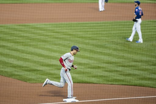 Washington Nationals Trea Turner runs the bases after hitting a home run as New York Mets starting pitcher Rick Porcello reacts during the first inning of a baseball game Tuesday, Aug. 11, 2020, in New York. (AP Photo/Frank Franklin II)