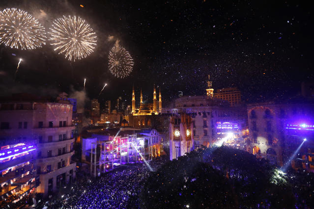 <p>Fireworks explode over the downtown Beirut, Lebanon, during New Year's celebrations, Monday, Jan. 1, 2018. (Photo: Hussein Malla/AP) </p>