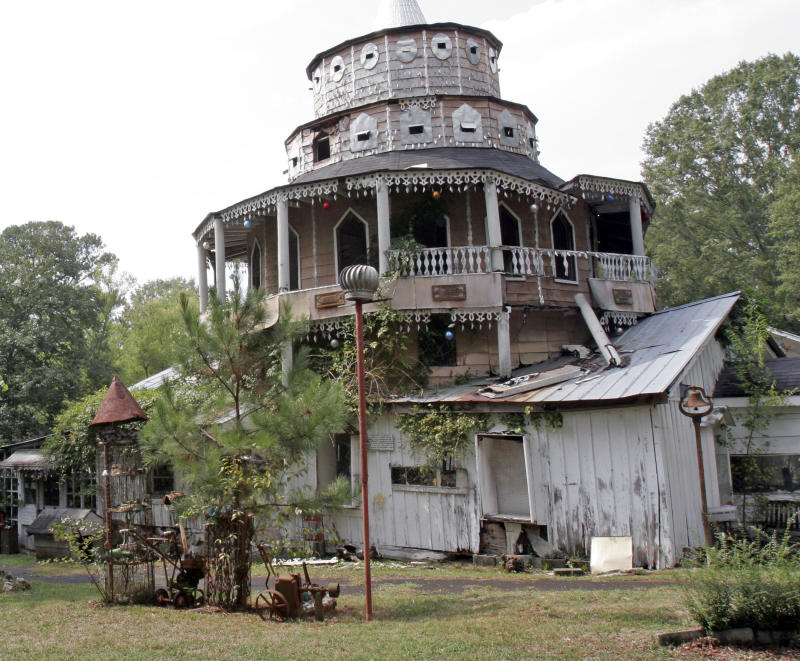 In this Thursday, Sept. 27, 2007 file photo, folk artist Howard Finster's World's Folk Art Church is shown at Paradise Gardens in Pennville, Ga.  A northwest Georgia county has bought the garden where the folk artist held court for tourists and art lovers from around the world. (AP Photo/Gene Blythe, File)