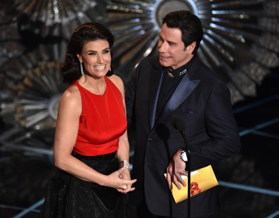 Idina Menzel, left and John Travolta present the award for best original song at the Oscars on Sunday, Feb. 22, 2015, at the Dolby Theatre in Los Angeles. (Photo by John Shearer/Invision/AP)