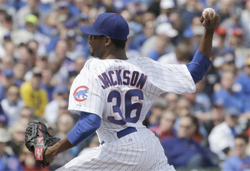 Chicago Cubs starter Edwin Jackson throws against the Milwaukee Brewers during the first inning of a baseball game in Chicago, Monday, April 8, 2013. (AP Photo/Nam Y. Huh)