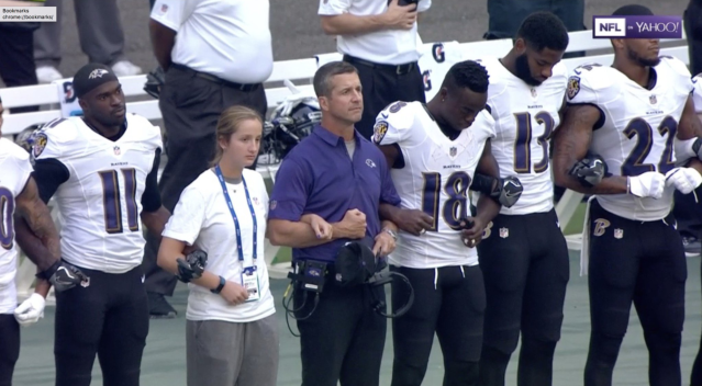 John Harbaugh stands with his players. (Via Yahoo screenshot)