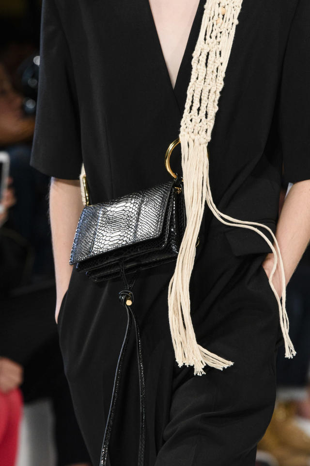<p><i>Crossbody black handbag with woven rope strap from the SS18 Stella McCartney collection. (Photo: ImaxTree) </i></p>