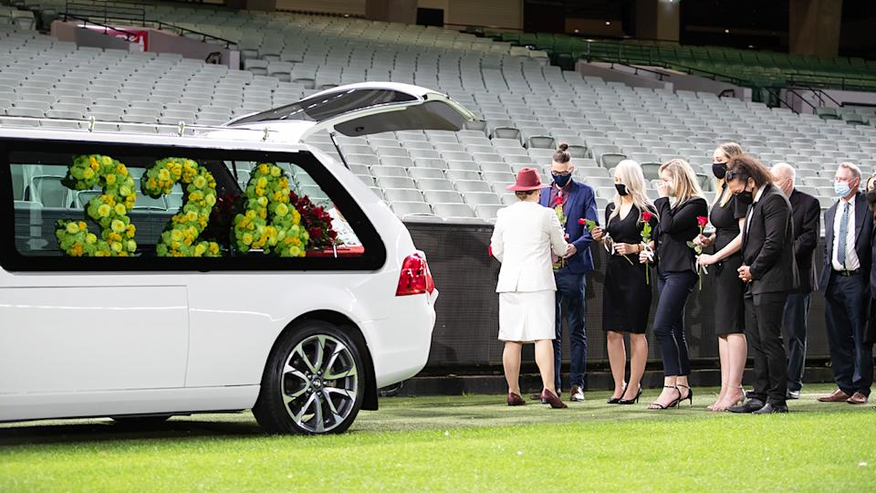 Family and mourners, pictured here at a private memorial for Dean Jones at the MCG.