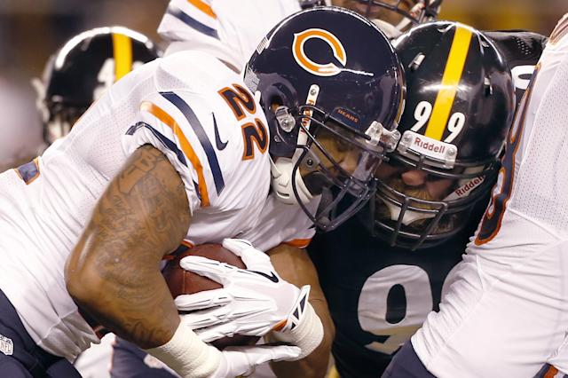 Chicago Bears running back Matt Forte (22) is hit by Pittsburgh Steelers defensive end Brett Keisel (99) in the first quarter of an NFL football game on Sunday, Sept. 22, 2013, in Pittsburgh. (AP Photo/Keith Srakocic)