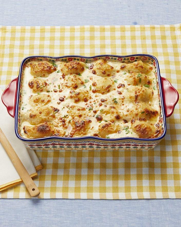 """<p>Combine creamy chicken Alfredo and hearty stuffed shells to create this decadent pasta casserole. It has four types of cheese!</p><p><strong><a href=""""https://www.thepioneerwoman.com/food-cooking/recipes/a97301/chicken-alfredo-stuffed-shells/"""" rel=""""nofollow noopener"""" target=""""_blank"""" data-ylk=""""slk:Get the recipe."""" class=""""link rapid-noclick-resp"""">Get the recipe.</a></strong> </p>"""