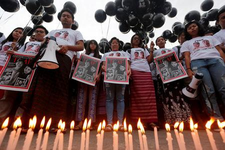 FILE PHOTO:  Candles burn, as activists gather at a rally, calling for the release of imprisoned Reuters journalists Wa Lone and Kyaw Soe Oo, one year after they were arrested, in Yangon, Myanmar December 12, 2018. REUTERS/Myat Thu Kyaw