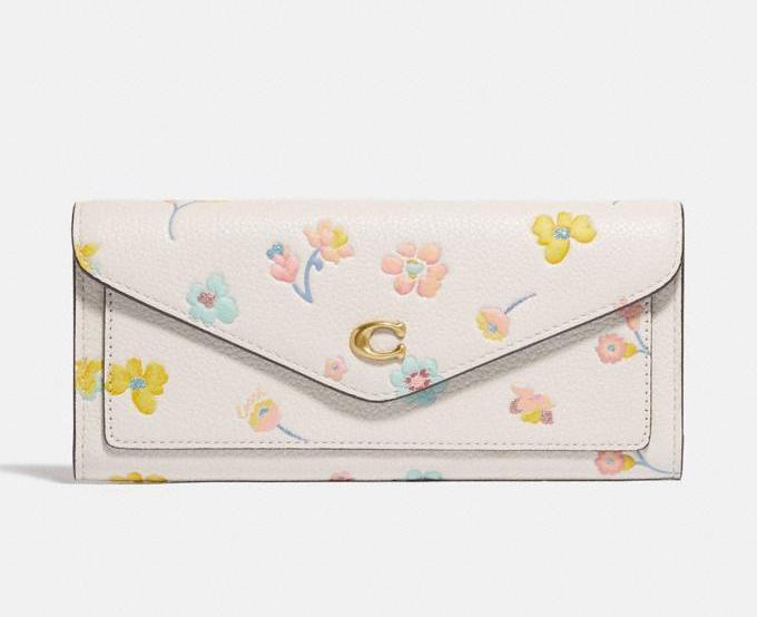 Wyn Soft Wallet With Watercolor Floral Print. Image via Coach.