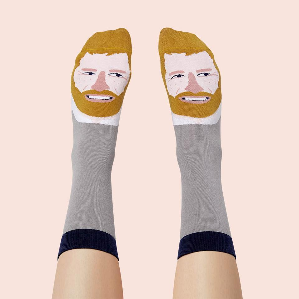 """<p>Every dad has a drawer full of socks, but we're pretty sure he's missing what's sure to be his favorite pair - featuring Prince Harry!</p> <p><strong>Chatty Feet Prince Hurry Feet Socks, <a href=""""https://www.chattyfeet.us/products/funny-socks-for-men-royal-gifts"""" rel=""""sponsored noopener"""" target=""""_blank"""" data-ylk=""""slk:$12"""" class=""""link rapid-noclick-resp"""">$12</a></strong></p>"""
