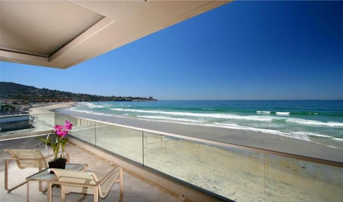Spanning 9,300 square feet, the three-story home overlooking the ocean expands to 50 feet of beach.