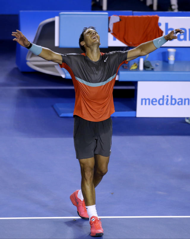 Rafael Nadal of Spain celebrates after defeating Roger Federer of Switzerland during their semifinal at the Australian Open tennis championship in Melbourne, Australia, Friday, Jan. 24, 2014.(AP Photo/Aijaz Rahi)