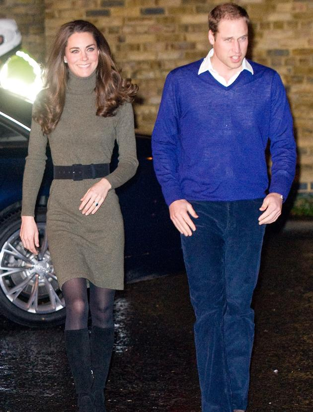 Kate Middleton photos: Kate's trusty black boots work on and off duty and she teamed these with a Ralph Lauren olive green turtle neck jumper for a charity visit.