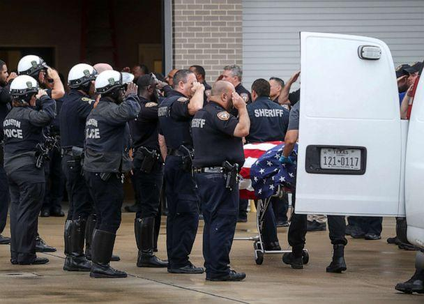 PHOTO: Law enforcement officers escort the body of Deputy Sandeep Dhaliwal, who was shot and killed after a traffic stop in Cypress earlier in the day, to the Harris County Institute of Forensic Sciences on Friday, Sept. 27, 2019, in Houston. (Jon Shapley/Houston Chronicle via AP)