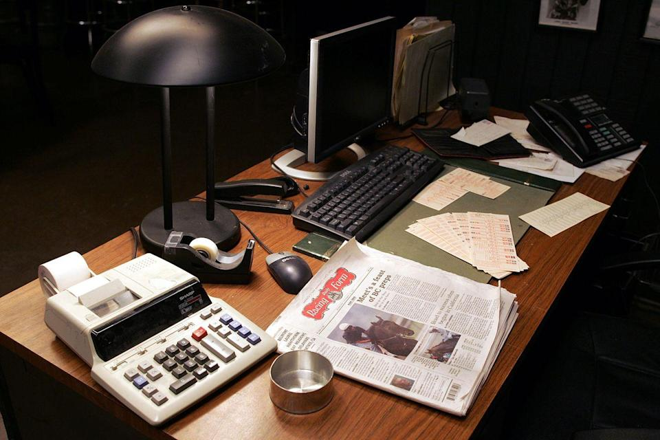 <p>Move in and you'll see some extra props: The newspaper, a calculator, tape, and a Dell computer. </p>