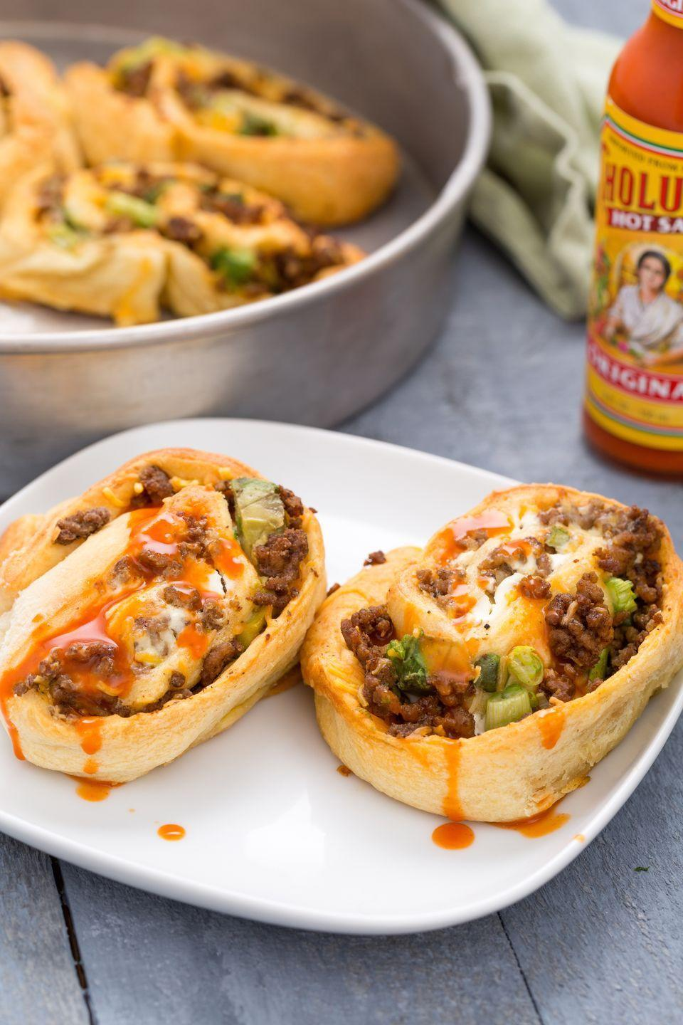 """<p>Anything tortillas can do, crescent rolls can do better.</p><p>Get the recipe from <a href=""""https://www.delish.com/cooking/recipe-ideas/recipes/a44344/beef-taco-roll-ups-recipe/"""" rel=""""nofollow noopener"""" target=""""_blank"""" data-ylk=""""slk:Delish"""" class=""""link rapid-noclick-resp"""">Delish</a>.</p>"""
