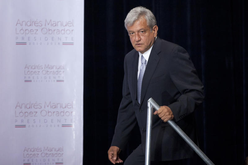 """Mexican presidential candidate Andres Manuel Lopez Obrador of the Democratic Revolution Party (PRD), arrives for a press conference in Mexico City, Monday, July 2, 2012. After official results showed Enrique Pena Nieto of the Institutional Revolutionary Party (PRI) winning 38 per cent of the vote with more than 92 per cent of the votes counted, Lopez Obrador has not conceded Sunday's elections, telling his supporters Monday evening that, """"We can't accept a fraudulent result,"""" a reference to his allegations that Pena Nieto exceeded campaign spending limits, bought votes in some states and benefited from favorable coverage in Mexico's semi-monopolized television industry. (AP Photo/Alexandre Meneghini)"""