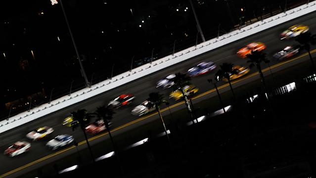DAYTONA BEACH, FL - FEBRUARY 27: Cars line up on the pace lap prior to the start of the NASCAR Sprint Cup Series Daytona 500 at Daytona International Speedway on February 27, 2012 in Daytona Beach, Florida. (Photo by Tom Pennington/Getty Images for NASCAR)