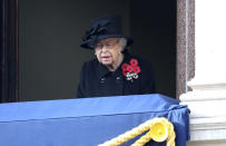 Britain's Queen Elizabeth II stands on the balcony of the Foreign Office, during the Remembrance Sunday service at the Cenotaph, in Whitehall, London, Sunday Nov. 8, 2020. (Chris Jackson/Pool Photo via AP)
