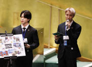 ADDS IDS - Members of South Korean K-pop band BTS, Jimin, left, and J-Hope speak at the United Nations meeting on Sustainable Development Goals during the 76th session of the U.N. General Assembly at U.N. headquarters on Monday, Sept. 20, 2021. (John Angelillo/Pool Photo via AP)
