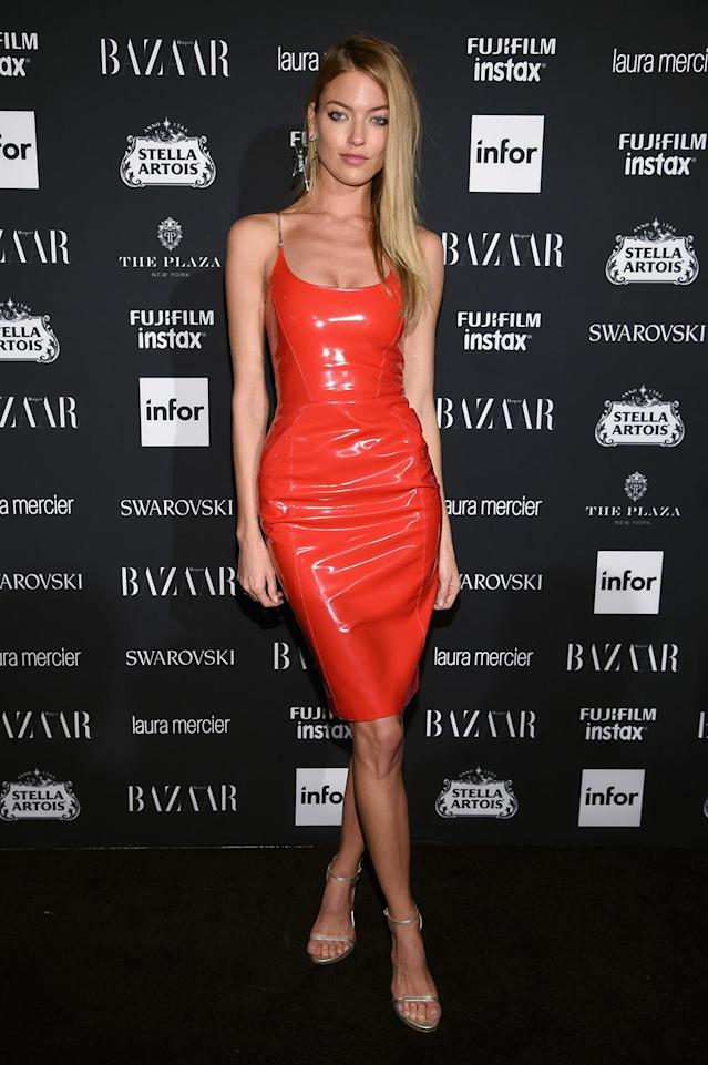 <p>Hunt attended the <em>Harper's Bazaar</em> Icons party, wearing red latex in the form of a spaghetti-strap dress. (Photo: Dimitrios Kambouris/Getty Images for Harper's Bazaar) </p>