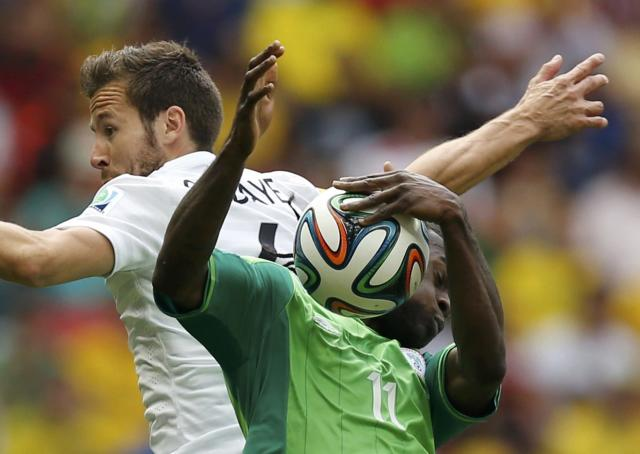 France's Yohan Cabaye (L) fights for the ball with Nigeria's Victor Moses during their 2014 World Cup round of 16 game at the Brasilia national stadium in Brasilia June 30, 2014. REUTERS/Ueslei Marcelino (BRAZIL - Tags: SOCCER SPORT WORLD CUP TPX IMAGES OF THE DAY)